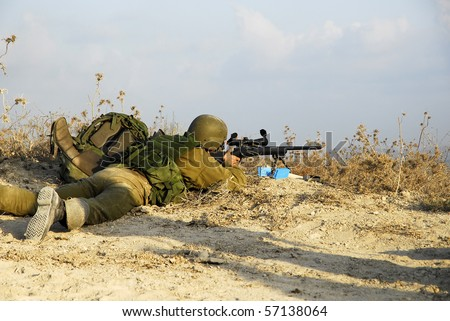 Israeli sniper in a battalion maneuver as part of regular training the army have. - stock photo