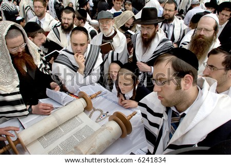 Israelites reading Thor in western wall. - stock photo