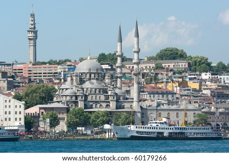 Istanbul and Yeni Mosque view on the Bosporus waterfront from Galata bridge - stock photo