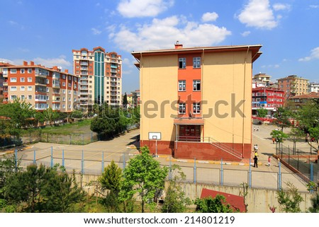ISTANBUL - APR 26, 2014: Primary school students playing during break time in the yard. Recess in Elementary School. It is that time of year when the summer winds down and children head back to school - stock photo