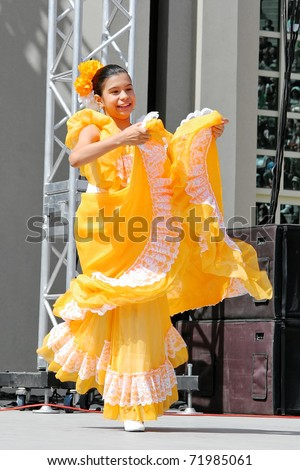 """ISTANBUL - APRIL 23: An unidentified 10 years old Colombian girl in traditional costume perform folk dance on """"National Sovereignty and Children Day"""" festival, April 23, 2010 in Istanbul, Turkey - stock photo"""