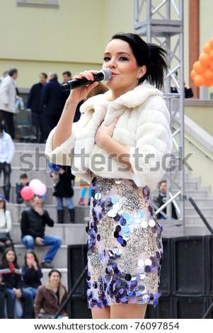 ISTANBUL - APRIL 23: Pop star Bengu Erden performs live on stage at Marmara Egitim Kurumlari on April 23, 2011 in Istanbul, Turkey. - stock photo