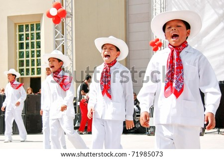 "ISTANBUL - APRIL 23: Unidentified 12 years old Mexican children in traditional costume perform folk dance on ""National Sovereignty and Children Day"" festival, April 23, 2010 in Istanbul, Turkey - stock photo"