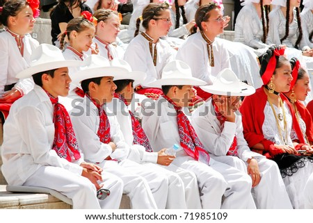 "ISTANBUL - APRIL 23: Unidentified 12 years old Mexican children in traditional costume wait their turn on ""National Sovereignty and Children Day"" festival, April 23, 2010 in Istanbul, Turkey - stock photo"