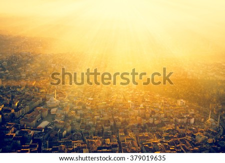 Istanbul at sunset in golden sun rays - panoramic view of the capital of Turkey. Roofs in urban areas of a large city - architectural background. Panorama of Istanbul, top view on the city landscape. - stock photo