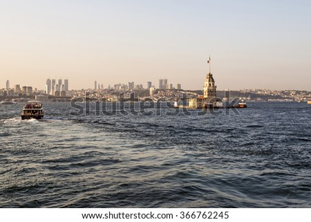 Istanbul at sunset with Maiden's tower in the foreground - stock photo