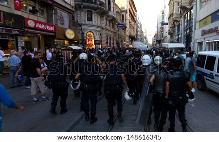ISTANBUL - AUGUST 03: Riot Control Vehicle intervene protestors in Istiklal Street on August 03, 2013 in Istanbul, Turkey. Police intervene unorganized small groups of anti-government protestors.