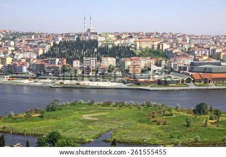 Istanbul city, Turkey. View of Golden Horn inlet and colorful houses on a hillside - stock photo