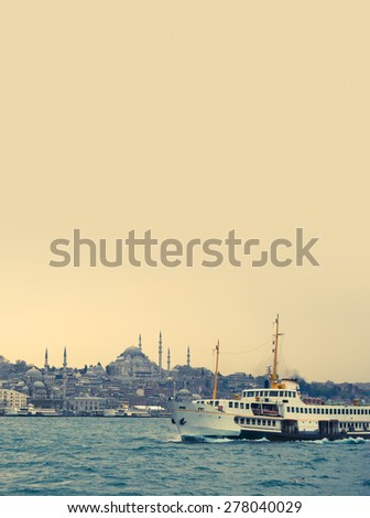 Istanbul cityscape view with turkish passenger ship in Golden Horn. Travel concept in Turkey with copy-space for your text, vertical photo with skyline, steamship and mosque. - stock photo
