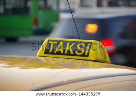 Istanbul close up of roof mounted sign on yellow taxi cab - stock photo