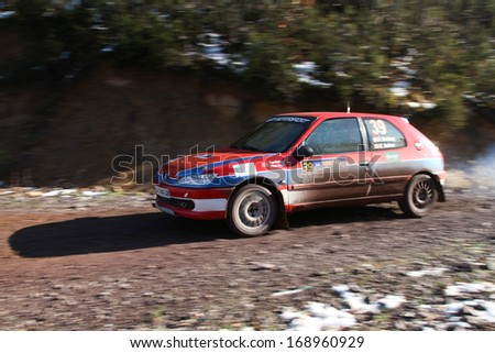 ISTANBUL - DECEMBER 15: Ilhan Mutluay drives Peugeot 306 S16 in 34th Opar Olio Istanbul Rally, Gocbeyli Stage on December 15, 2013 in Istanbul, Turkey.