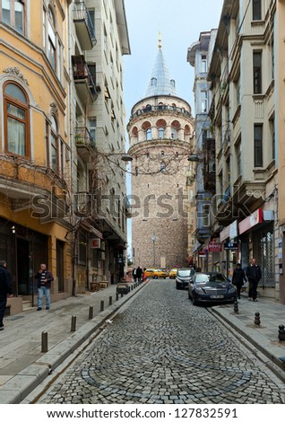 ISTANBUL - DECEMBER 30:  Tourists on the top of Galata Tower in Istanbul on December 12, 2012 in Istanbul, Turkey. This is a medieval stone tower one of the city's most striking landmarks. - stock photo