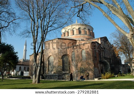 ISTANBUL - DECEMBER 24: Tourists visiting the Saint Irina church, placed inside of the Topkapi palace near the Hagia Sophia. On December 24, 2006 in Istanbul, Turkey - stock photo