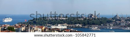 Istanbul in panoramic view. Right to Left Blue Mosque, Hagia Sophia and Topkapi Palace seen from above - stock photo
