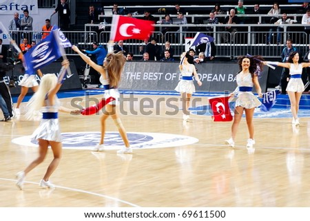 ISTANBUL - JANUARY 20: Efes Pilsen Cheerleaders perform routines at THY Euroleage Top 16 Championship basketball game Efes Pilsen vs Montepaschi Siena January 20, 2011 in Istanbul
