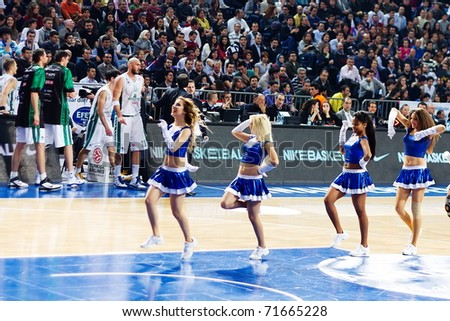 ISTANBUL - JANUARY 20: Efes Pilsen Cheerleaders perform routines at THY Euroleage Top 16 Championship basketball game Efes Pilsen vs Montepaschi Siena January 20, 2011 in Istanbul - stock photo