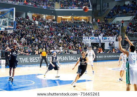 ISTANBUL - JANUARY 20: Marco Carraretto (9) takes a three point shot at THY Euroleage Top 16 Championship basketball game, Efes Pilsen vs Montepaschi Siena January 20, 2011 in Istanbul, Turkey - stock photo
