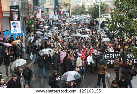 ISTANBUL - JANUARY 19: Thousands mark Hrant Dinks death 6 years on. More than 10,000 protesters walked from Sisli to Agos newspaper under rain, on 19 January 2013 in Istanbul,Turkey.
