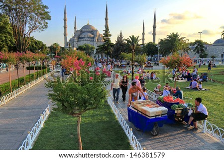 ISTANBUL - JUL 15: Blue Mosque at Sultanahmet Square on Ramadan, July 15, 2013 in Istanbul, Turkey. At the end of the day the fast is broken with prayer and a meal called the iftar. - stock photo