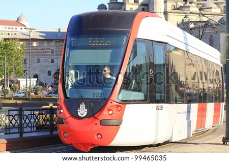 ISTANBUL - JULY 22: A modern tram on Galata Bridge on July 22, 2011 in Istanbul. Due to increasing traffic & air pollution, Istanbul became one of most polluted city also planned for return of tram. - stock photo