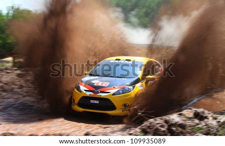 ISTANBUL - JULY 07: Bugra Banaz drives a Ford Fiesta R2 car during 41st Bosphorus Rally ERC Championship, Gocbeyli Stage on July 7, 2012 in Istanbul, Turkey. - stock photo