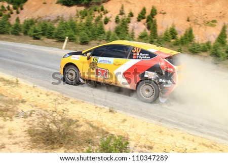 ISTANBUL - JULY 08: Bugra Banaz drives a Ford Fiesta R2 car during 41st Bosphorus Rally ERC Championship, Halli Stage on July 8, 2012 in Istanbul, Turkey. - stock photo