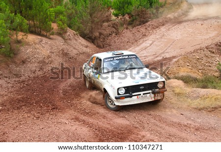 ISTANBUL - JULY 08: Kemal Gamgam drives a Ford Escort Mk2 car during 41st Bosphorus Rally ERC Championship, Halli Stage on July 8, 2012 in Istanbul, Turkey. - stock photo