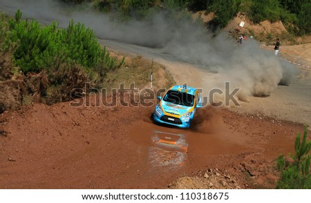 ISTANBUL - JULY 07: Ozcan Soke drives a Ford Fiesta R2 car during 41st Bosphorus Rally ERC Championship, Gocbeyli Stage on July 7, 2012 in Istanbul, Turkey. - stock photo