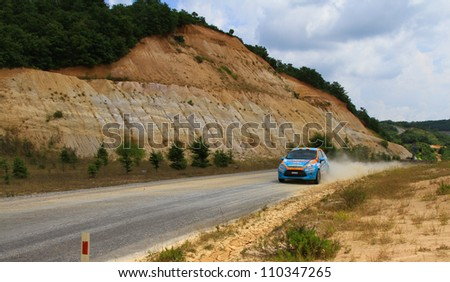 ISTANBUL - JULY 08: Ozcan Soke drives a Ford Fiesta R2 car during 41st Bosphorus Rally ERC Championship, Halli Stage on July 8, 2012 in Istanbul, Turkey. - stock photo
