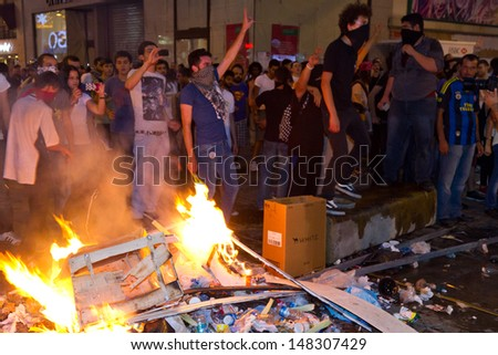 ISTANBUL - JULY 31: People made barricade in Istiklal Street on July 31, 2013 in Istanbul, Turkey. People gathered and protest for Berkin Elvan who was shot in the head with a tear gas canister. - stock photo