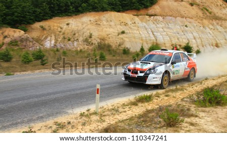 ISTANBUL - JULY 08: Sabri Unver drives a Subaru Impreza car during 41st Bosphorus Rally ERC Championship, Halli Stage on July 8, 2012 in Istanbul, Turkey.