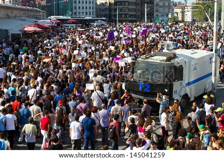ISTANBUL - JULY 06: Women in Taksim Square to protest police violence and abuse on July 06, 2013 in Istanbul, Turkey.