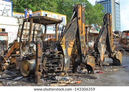 ISTANBUL - JUN 13: Protests turn to violent as police crack down on June 13, 2013 in Istanbul, Turkey. Construction machines had been parked on the part of Taksim Square being reconstructed.