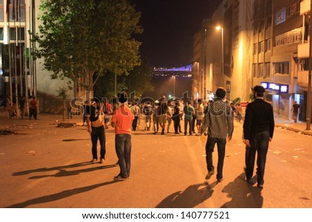 ISTANBUL - JUN 1: Violence sparked by plans to build on the Gezi Park have broadened into nationwide anti government unrest on June 1, 2013 in Istanbul, Turkey. Gumussuyu Street - stock photo