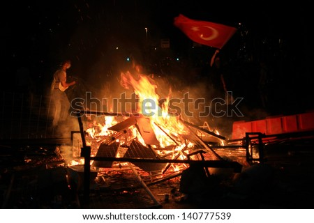 ISTANBUL - JUN 1: Violence sparked by plans to build on the Gezi Park have broadened into nationwide anti government unrest on June 1, 2013 in Istanbul, Turkey.  Dolmabahce Palace Road
