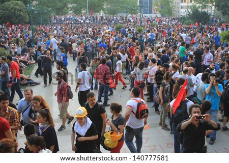 ISTANBUL - JUN 1: Violence sparked by plans to build on the Gezi Park have broadened into nationwide anti government unrest on June 1, 2013 in Istanbul, Turkey. Taksim Gezipark - stock photo
