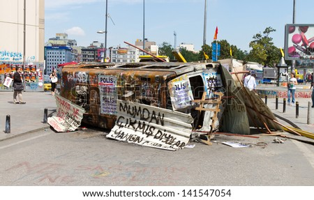 ISTANBUL - JUNE 08: Barricade by van around Taksim Square during protests on June 08, 2013 in Istanbul, Turkey. People do not allow police to enter Taksim Square before their requests are accepted.