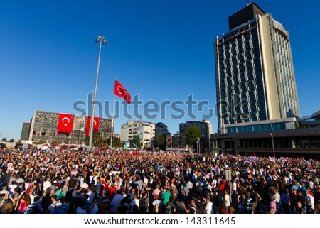 ISTANBUL - JUNE 22: Commemoration for dead during protests in Taksim Square on June 22, 2013 in Istanbul, Turkey. People came Taksim Square with red carnations. - stock photo