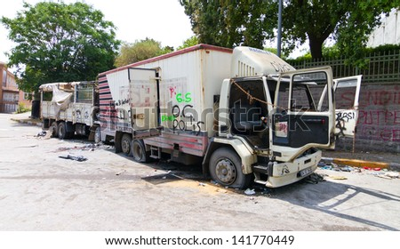 ISTANBUL - JUNE 08: Damaged trucks during protests on June 08, 2013 in Istanbul, Turkey. Police used disproportionate force to protesters at Taksim in first three days.