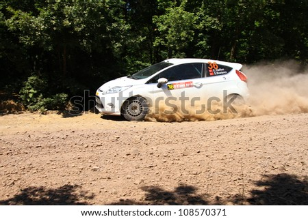 ISTANBUL - JUNE 10: Eytan Halfon drives a Ford Fiesta R2 car during 33th Istanbul Rally championship, ISG Stage on June 10, 2012 in Istanbul, Turkey. - stock photo