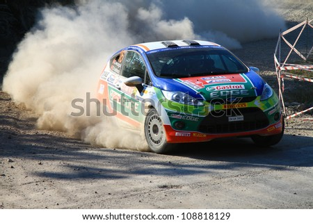 ISTANBUL - JUNE 10: Orhan Avcioglu drives a Castrol Ford Team Turkiye Ford Fiesta R2 car during 33th Istanbul Rally championship, Yesilvadi Stage on June 10, 2012 in Istanbul, Turkey. - stock photo