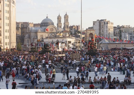 ISTANBUL - JUNE 01 2013 : People are at Taksim Square to protest against Taksim Gezi Park demolition in Turkey. Protests developed into anti-government demonstrations and occupying taksim square - stock photo