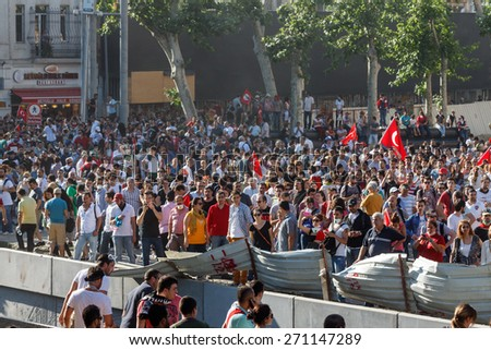 ISTANBUL - JUNE 01 2013 : People are at Taksim Square to protest against Taksim Gezi Park demolition in Istanbul, Turkey. Protests developed into anti-government demonstrations and occupying Gezi Park