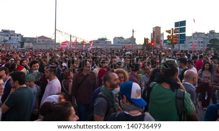 ISTANBUL - JUNE 01: People are at Taksim Square to protest on June 01, 2013 in Istanbul, Turkey. Clashes are one of the most challenging events for Prime Minister Recep Tayyip Erdan's ten-year rule - stock photo