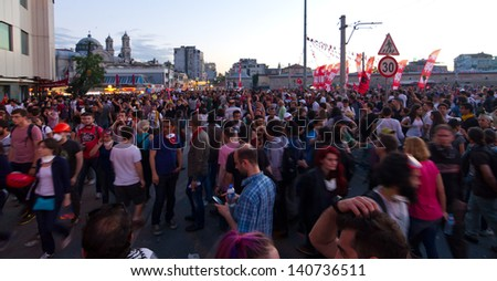 ISTANBUL - JUNE 01: People are at Taksim Square to protest on June 01, 2013 in Istanbul, Turkey. Clashes are one of the most challenging events for Prime Minister Recep Tayyip Erdoan's ten-year rule - stock photo