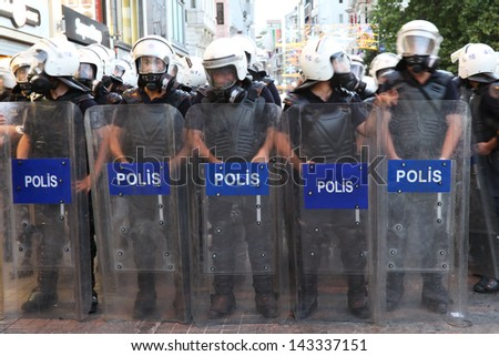 ISTANBUL - JUNE 22: Police forces in ���stiklal Street on June 22, 2013 in Istanbul, Turkey. People came Taksim Square with red carnations to commemoration for dead during protests - stock photo