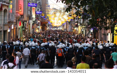 ISTANBUL - JUNE 22: Police intervention to protestors in ���stiklal Street on June 22, 2013 in Istanbul, Turkey. People came Taksim Square with red carnations to commemoration for dead during protests - stock photo