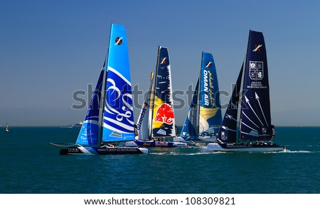 ISTANBUL - JUNE 09: Red Bull Sailing, Groupe Edmond De Rothschild and The Wave, Muscat team boats compete in the Extreme Sailing Series, on June 09, 2012 Istanbul, Turkey.