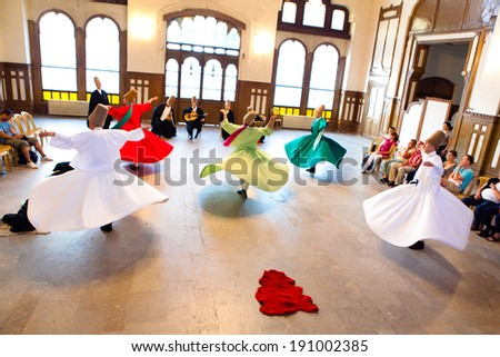 ISTANBUL - JUNE 18: Whirling Dervishes perform a sacred mevlana dance at Serkeci Train Station on June 18, 2011 in Istanbul, Turkey. - stock photo
