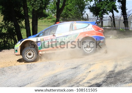 ISTANBUL - JUNE 10: Yagiz Avci drives a Castrol Ford Team Turkiye Ford Fiesta S2000 car during 33th Istanbul Rally championship, ISG Stage on June 10, 2012 in Istanbul, Turkey. - stock photo